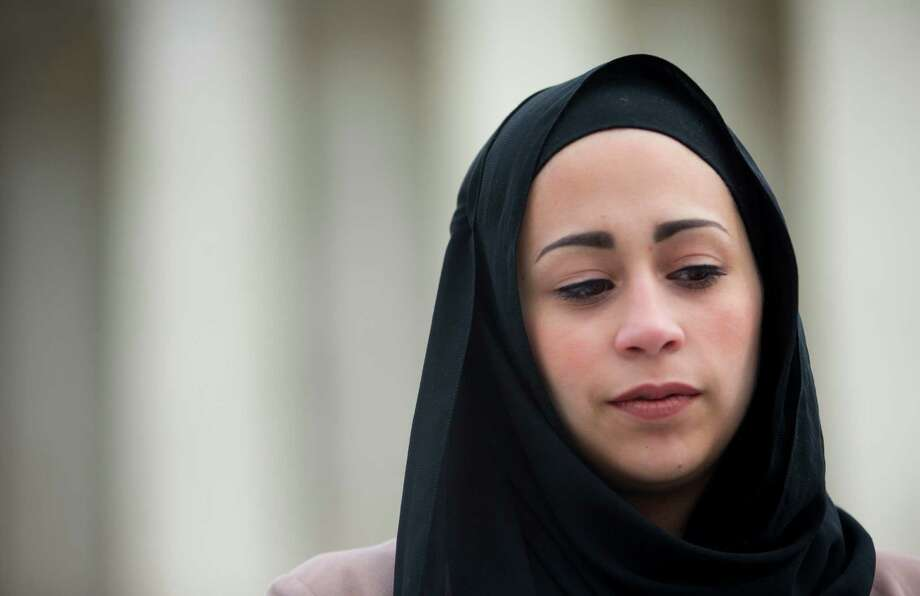 Samantha Elauf stands outside the Supreme Court in Washington, Wednesday, Feb. 25, 2015. The Supreme Court is indicating it will side with a Muslim woman who didn't get hired by clothing retailer Abercrombie & Fitch because she wore a black headscarf that conflicted with the company's dress code to her job interview. Liberal and conservative justices aggressively questioned the company's lawyer during arguments at the high court Wednesday in a case that deals with when an employer must take steps to accommodate the religious beliefs of a job applicant or worker.  (AP Photo/Pablo Martinez Monsivais) ORG XMIT: DCPM110 Photo: Pablo Martinez Monsivais / AP