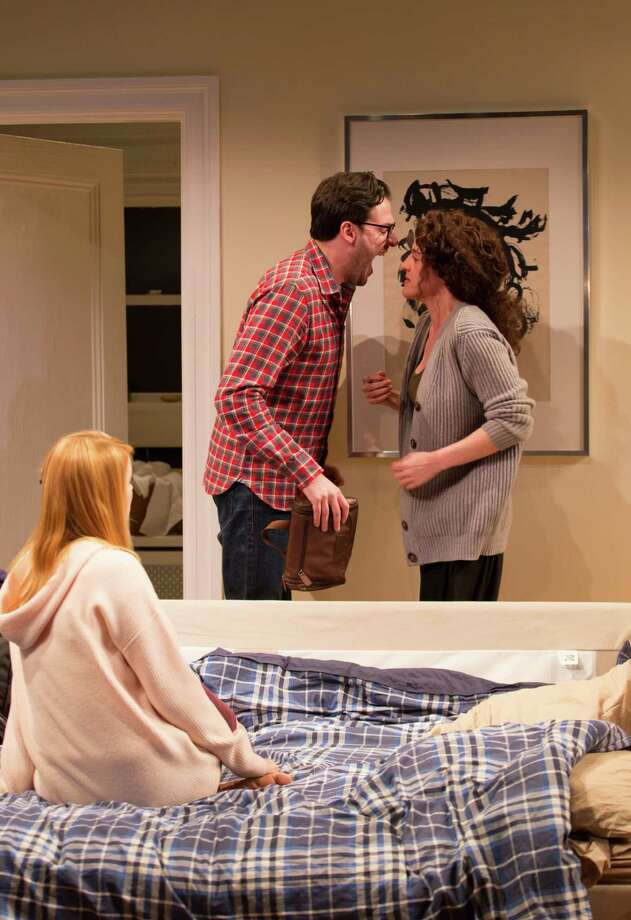 "A New York Jewish family melts down in the wake of the patriarch's death in Joshua Harmon's black comedy ""Bad Jews"" at Long Wharf through March 28. In the scene above, the cousins played by Michael Steinmetz and Keilly McQuail almost come to blows in front a horrified visitor played by Christy Escobar. Photo: Contributed Photo / Connecticut Post Contributed"