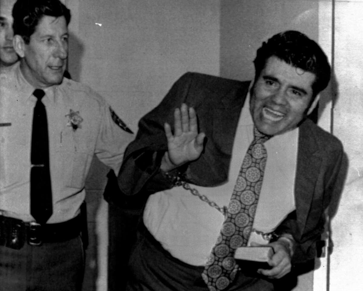 Convicted mass slayer Juan Corona waves as he leaves the Solano County Hall of Justice in Fairfield on Feb. 5, 1973. Corona was convicted of the mass slayings of 25 itinerant farm workers and burying their bodies in orchard graves north of Yuba City.