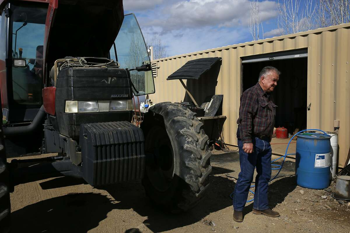 Mike Sagardia, 67, works on repairs to a tractor on the farm he owns with his brother Bert Feb. 27, 2015 in Firebaugh, Calif. The Bureau of Reclamation announced Friday that Westlands Water District will receive zero percent water allocation this year. The Sagardia brothers, who farm about 630 acres of almonds will most likely spend this year simply attempting to keep their remaining trees alive with the little water they have leftover from last year. Their only other option is to attempt to buy water on the open market, but they say the prices have increased tenfold over the years and it may be out of their financial reach.