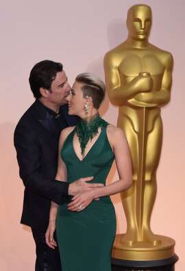 "The internet deemed this and other photos of the pair on the red carpet ""creepy.""   Scarlett Johansson (L) talks with John Travolta on the red carpet for the 87th Oscars on February 22, 2015 in Hollywood, California."