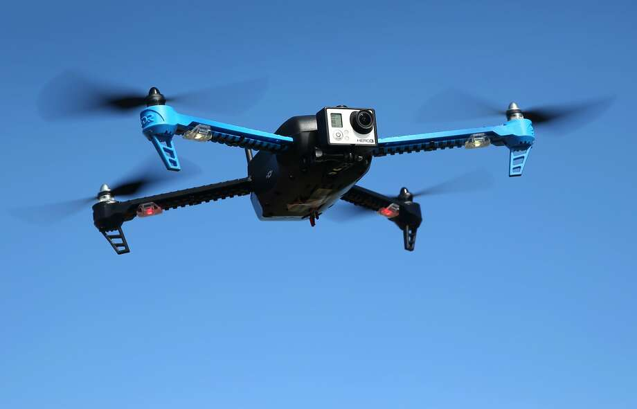 A drone with a camera mounted in front flies above Brisbane, Calif. on Friday, Feb. 27, 2015. A team of developers have created the iDroneLink system, which controls and operates drones using an iPhone or iPad. Drone use is likely to skyrocket following new rules proposed by the FAA that are less restrictive than opponents were hoping for. Photo: Paul Chinn, The Chronicle