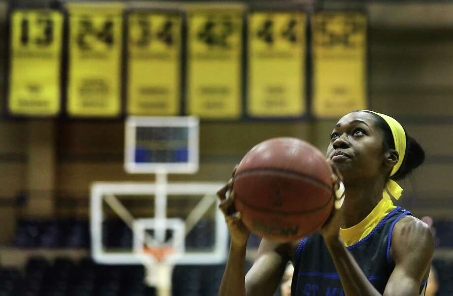 Morgan Pullins is a senior on St. Mary's University Lady Rattlers basketball team who is putting up huge numbers during her senior year. Photo: Bob Owen /San Antonio Express-News / © 2015 San Antonio Express-News