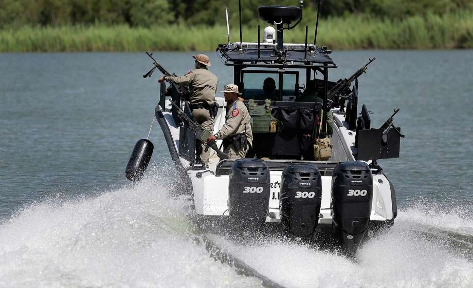 Texas Department of Safety Troopers patrol on the Rio Grande along the U.S.-Mexico border in ths file photo from September. The state's massive buildup of troopers on the border makes little sense. Photo: Eric Gay /Associated Press / AP