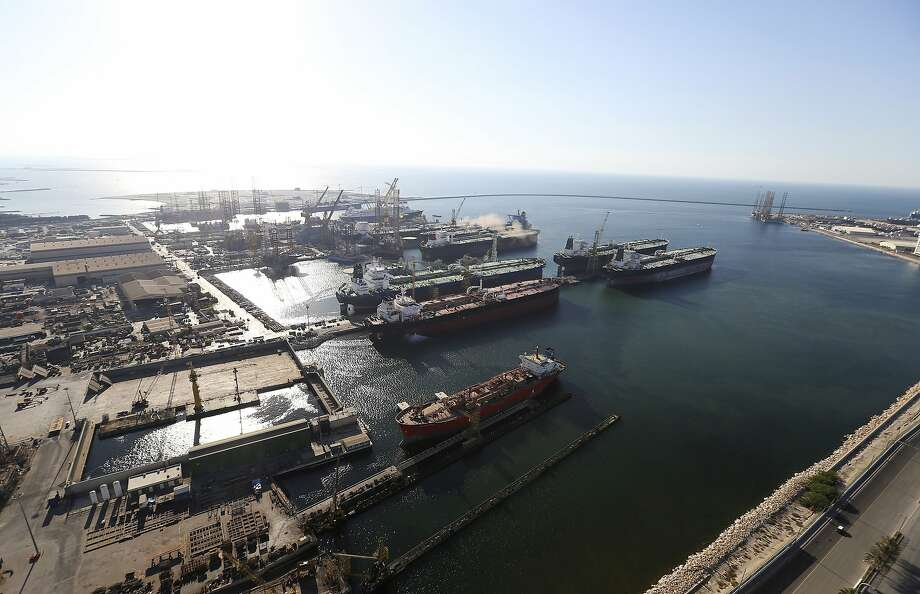 Oil tankers sit in the commercial harbor during shipping operations at Port Rashid in Dubai, United Arab Emirates, on Tuesday, Nov. 11, 2014. Declining currencies in European countries whose citizens are among the leading buyers of Dubai homes are combining with falling oil prices and a tax on foreign property held by Indians to push down home prices in the emirate. Photographer: Chris Ratcliffe/Bloomberg Photo: Chris Ratcliffe, Bloomberg