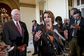 House Minority Leader Nancy Pelosi, D-Calif., accompanied by House Minority Whip Steny Hoyer, D-Md., gestures during a news conference Friday to voice their objections to the Republican majority during a delay in voting for a short-term spending bill for the Homeland Security Department.