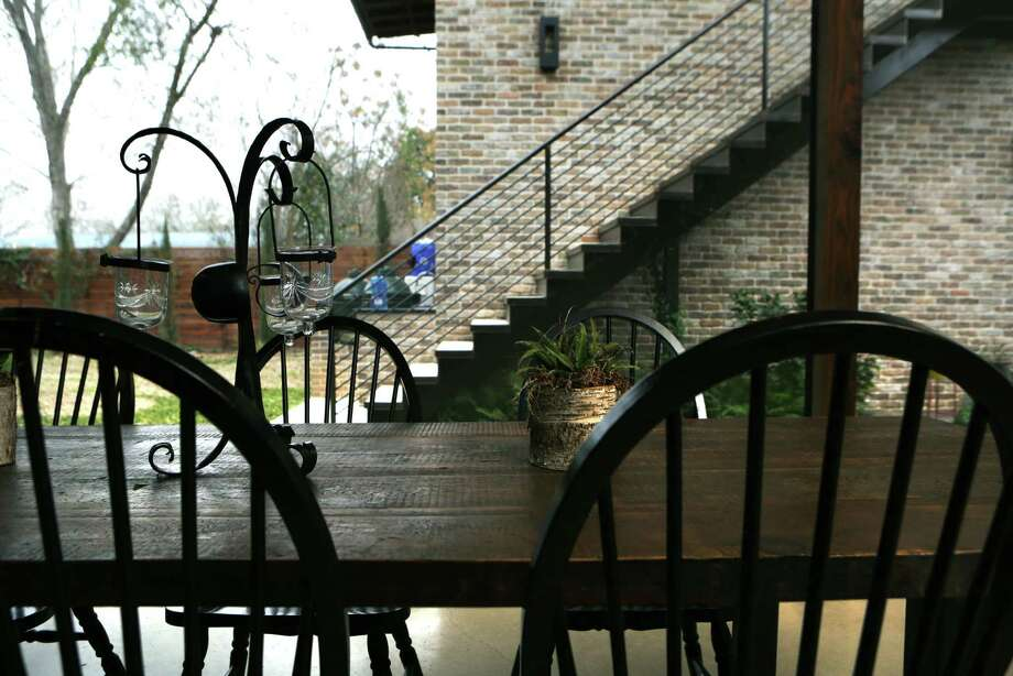 For a family that enjoys the outdoors, architect Kristin Wiese Hefty designed a screened porch that doubles as a second living and dining area. Photo: Bob Owen /San Antonio Express-News / © 2015 San Antonio Express-News
