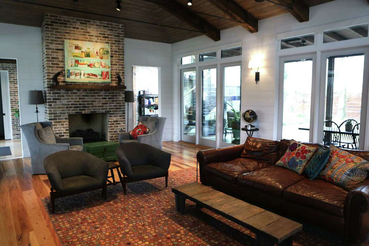 The homeowner said she and her husband enjoy having tea by the living room fireplace in the morning.