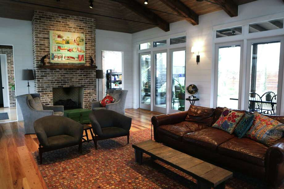 The homeowner said she and her husband enjoy having tea by the living room fireplace in the morning. Photo: Bob Owen /San Antonio Express-News / © 2015 San Antonio Express-News