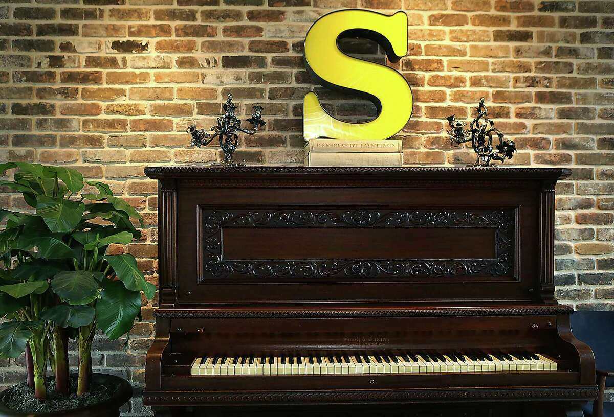 The homeowners had a 1901 piano, found in a basement in a San Antonio convent, refurbished and gave it a place of distinction in the entryway of their house. Candlesticks that were in the previous house on the property had been damaged by vandals, but the homeowner said she liked their character and their history on the site.