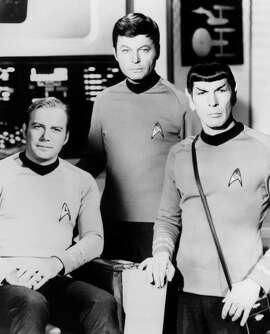 "Leonard Nimoy (right) inspired viewers as the half- human, half-Vulcan Spock on ""Star Trek,"" co-star ring William Shatner (left) and DeForest Kelley."