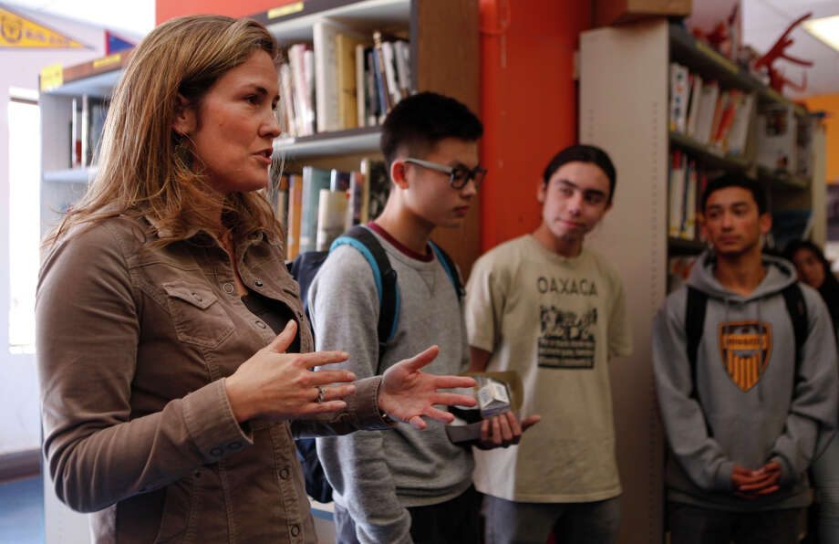 Lindsay Hower, executive director of Summer Search, visits with students at Mission High School in San Francisco. Summer Search received a $500,000 grant from the Super Bowl host committee's charity arm. Photo: Jessica Christian / The Chronicle / ONLINE_YES