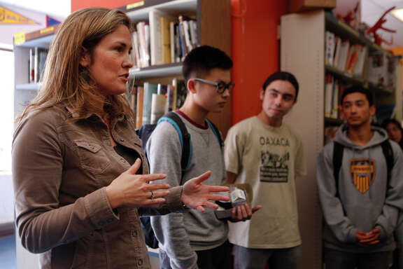 Lindsay Hower, executive director of Summer Search, visits with students at Mission High School in San Francisco. Summer Search received a $500,000 grant from the Super Bowl host committee's charity arm.