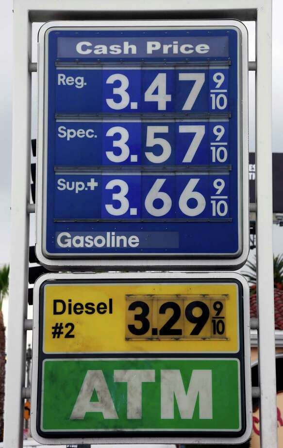A sign at a gas station in Los Angeles posts the latest gas prices on Friday, Feb. 27, 2015. Gas prices in California soared overnight as a result of a combination of supply-and-demand factors worsened by the shutdown of two refineries that produce a combined 16 percent of the state's gasoline. (AP Photo/Nick Ut) Photo: Nick Ut / Associated Press / AP