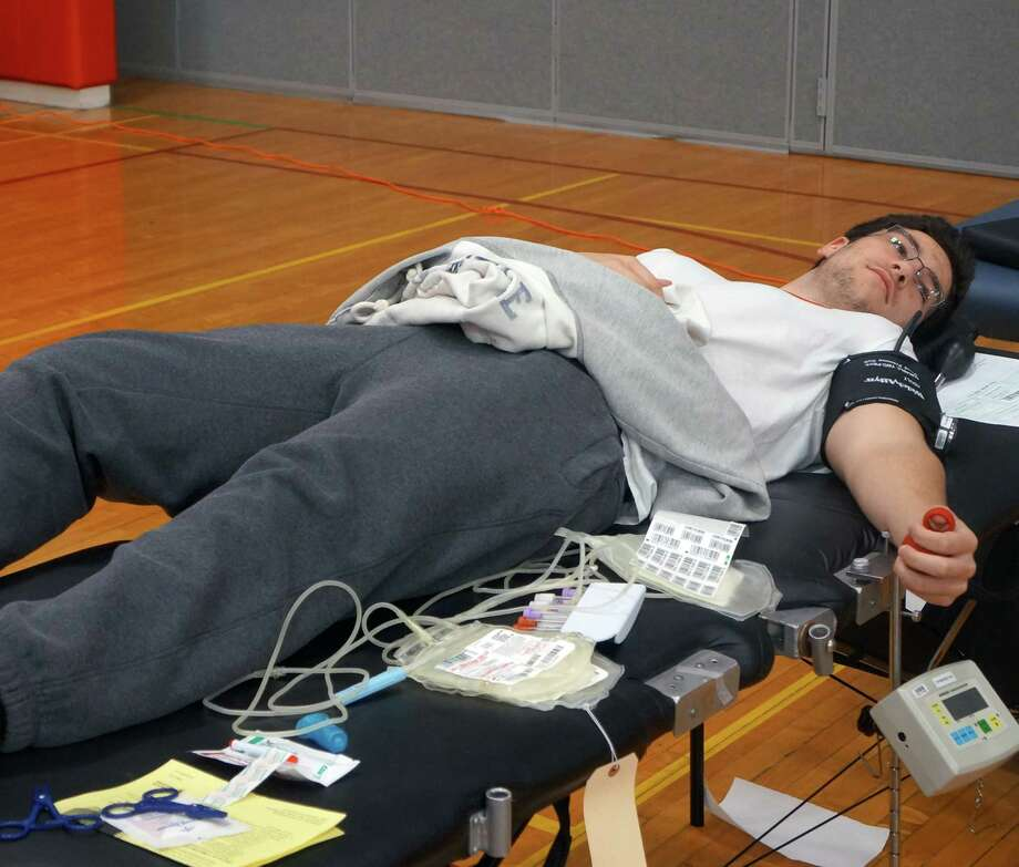 Greenwich High School senior Matheus Souza waits to get his blood drawn during the blood drive at the high school on Friday, Feb. 27, 2015. Greenwich, Conn. Photo: Paul Schott / Greenwich Time