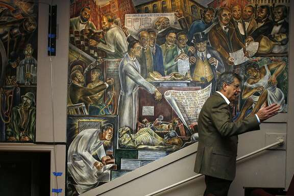 Professor Robert Schindler talks about the murals painted by artist Bernard Zacheim in Toland Hall at UCSF Parnassus campus in San Francisco, California on Friday, February 27, 2015.