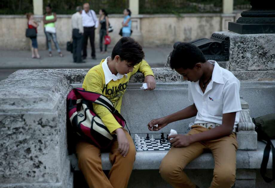 Children play a game of  chess in a park on Friday in Havana, Cuba. This week in  Washington D.C., the second round of diplomatic talks between U.S.  and  Cuban officials is an effort to restore full diplomatic  relations and move toward opening trade.  (Photo by Joe Raedle/Getty  Images) Photo: Joe Raedle, Getty / 2015 Getty Images