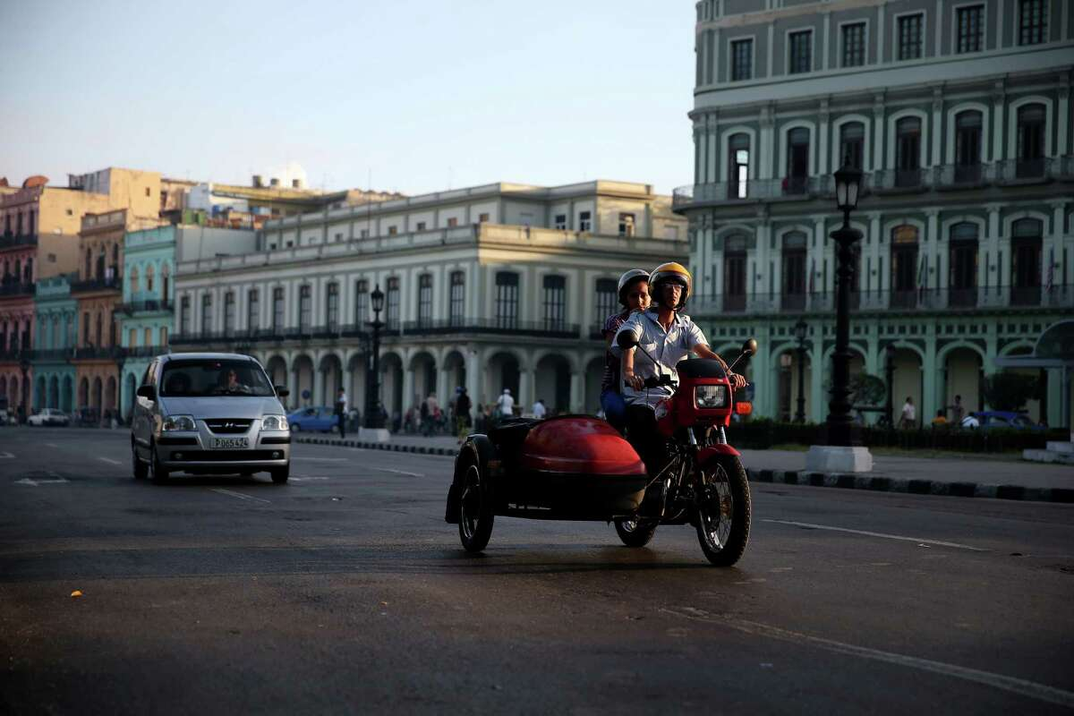 Traffic moves through the streets on Friday in Havana, Cuba. This week in Washington D.C., the second round of diplomatic talks between U.S. and Cuban officials is an effort to restore full diplomatic relations and move toward opening trade.