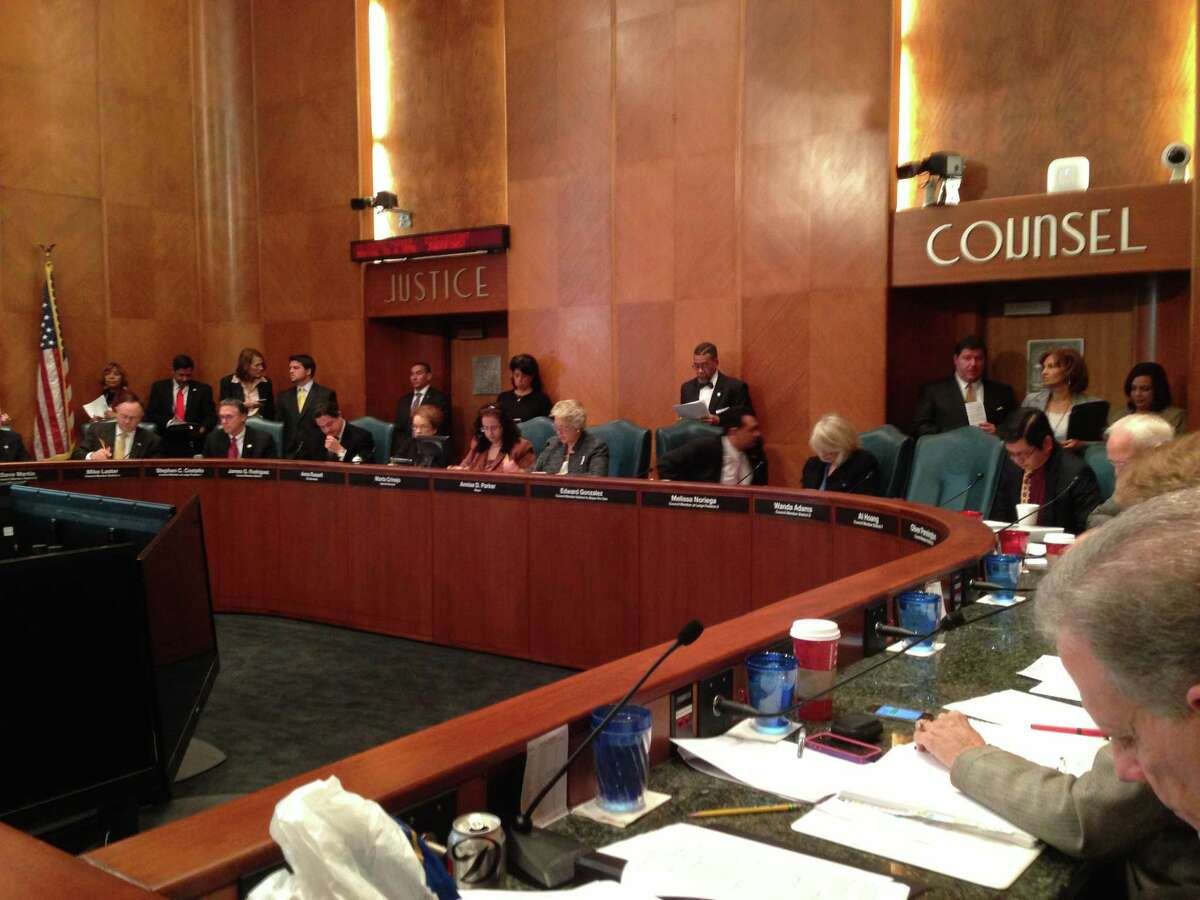 Houston City Council listens to Mayor Annise Parker at a council meeting on Nov. 20, 2013.