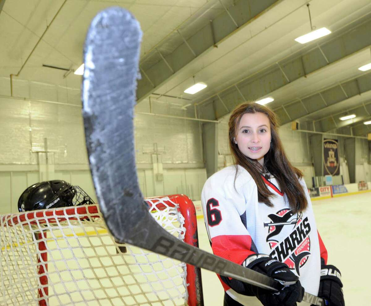 Mary Leydon, 13, a member of the Sharks ice hockey team, works out at the Twin Rinks in Stamford, Conn., Tuesday, Jan. 13, 2015. Leydon, a Cloonan Middle School 8th grader, plays hockey in an age bracket where checking is permitted. Leydon said she is a N.Y. Ranger hockey fan.