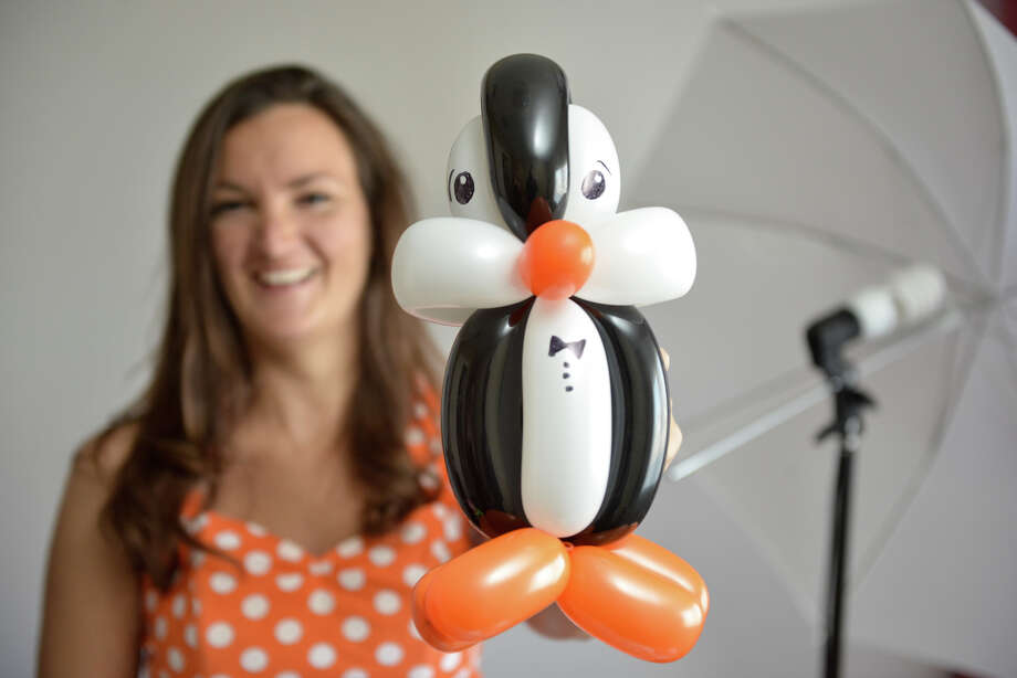 A balloon penguin by San Antonio professional balloon artist Holly Hopper. Hopper also produces youtube tutorials on balloon artistry from a studio in her West Side home. Photo: Photos By Robin Jerstad /San Antonio Express-News