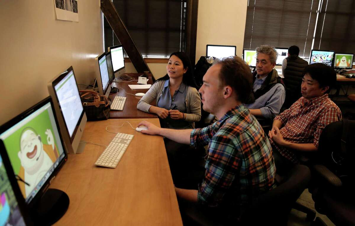 Joe McCarron (front) of Zendesk guides students Miao Ye, Winston Wu and Kit Te through the Zendesk Basics Community Certification Training Program.