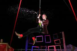 "Winemaker Jean-Charles Boisset welcomed guests in an unconventional way to the ""Napa Gras"" party at Raymond Vineyards on Feb. 20. The party had a burlesque theme, prompting him to slide into aerial slings for a provocative effect."