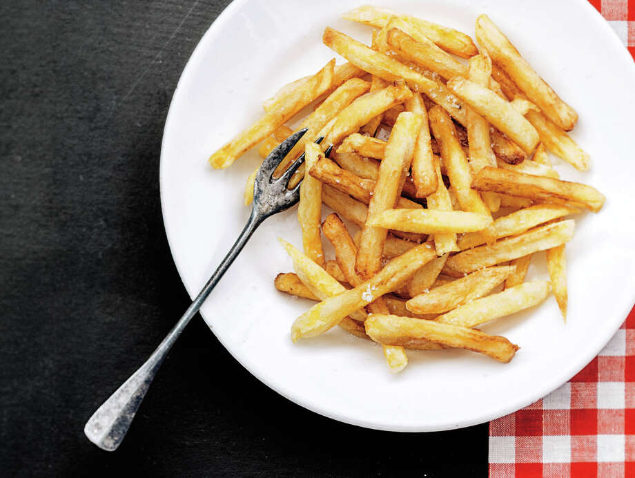 """Frites, fries, chips — by any name, the sliced and fried potatoes we call french fries are a culinary mainstay. From """"Frites,"""" by Anne de la Forest. Photo: Guillaume Czerw /Courtesy Photo"""