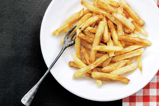 """Frites, fries, chips — by any name, the sliced and fried potatoes we call french fries are a culinary mainstay. From """"Frites,"""" by Anne de la Forest."""