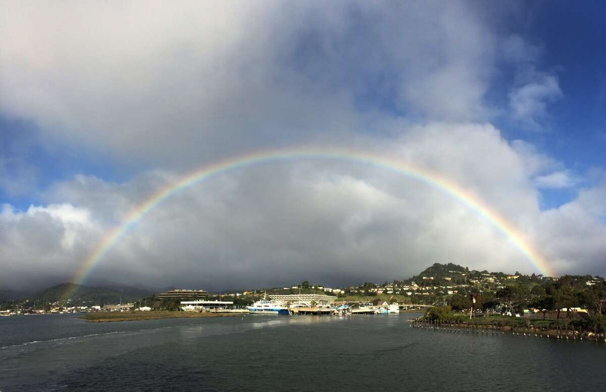A rainbow is visible over Larkspur on Friday, Feb. 27, 2015, as seen from the Golden Gate Ferry.