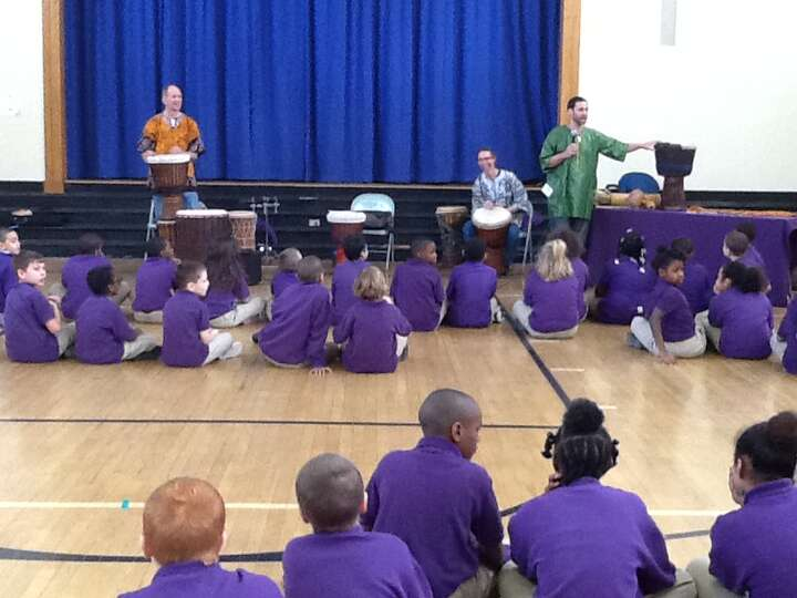 Students in third- to fifth-grades at School 2 in Troy welcome the African percussion ensemble Dound