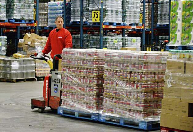 Lift operator Chuck Millie begins loading the the 1,300 cases (17,780 pounds) of food that Price Chopper is donating to the Regional Food Bank of Northeastern New York at the Price Chopper distribution center Friday Feb. 27, 2015 in Schenectady, NY.  (John Carl D'Annibale / Times Union) Photo: John Carl D'Annibale / 00030804A
