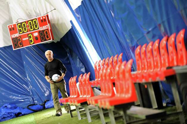 Owner Afrim Nezaj walks by the scoreboard and some of the bleacher seating inside his newest indoor soccer complex on Friday, Feb. 27, 2015, at Afrim's Sports in Bethlehem, N.Y. (Cindy Schultz / Times Union) Photo: Cindy Schultz / 00030773A