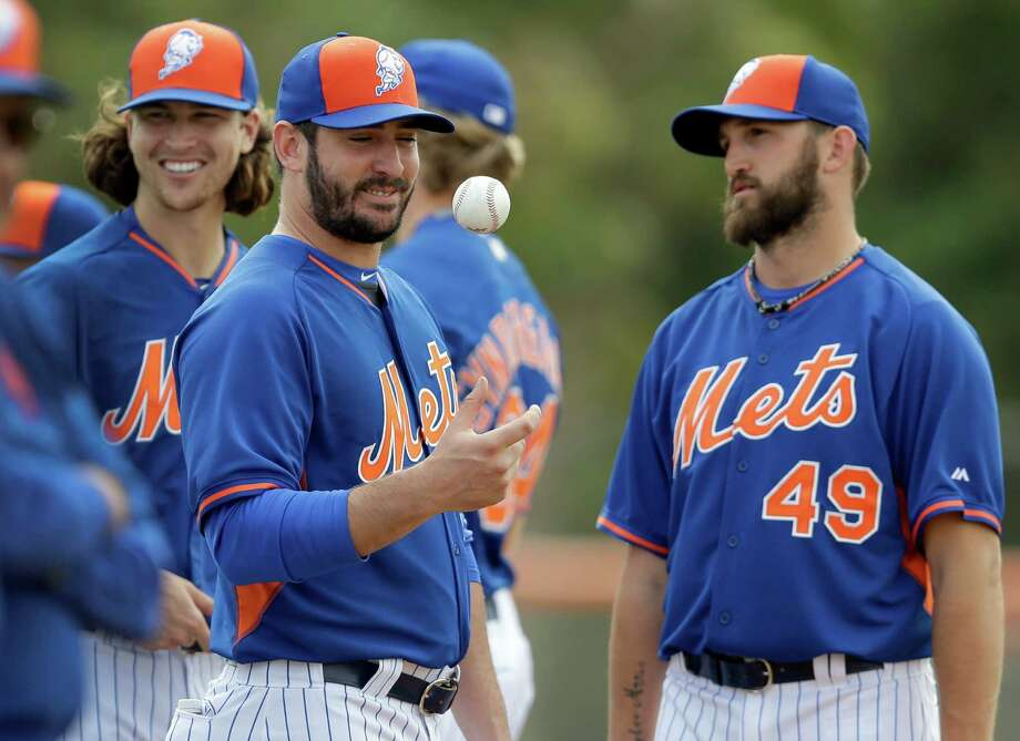 New York Mets pitcher Matt Harvey, center, flips a ball alongside teammates Jacob deGrom, left, and Jonathon Niese during spring training baseball practice Thursday, Feb. 26, 2015, in Port St. Lucie, Fla. (AP Photo/Jeff Roberson)  ORG XMIT: FLVR118 Photo: Jeff Roberson / AP