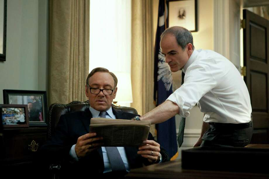 "In this image released by Netflix, Kevin Spacey (left) and Michael Kelly appear in a scene from ""House of Cards."" The third season of the political drama became available Friday on Netflix. on Friday Feb. 27, 2015. (AP Photo/Netflix) Photo: Melinda Sue Gordon /Associated Press / Netflix"