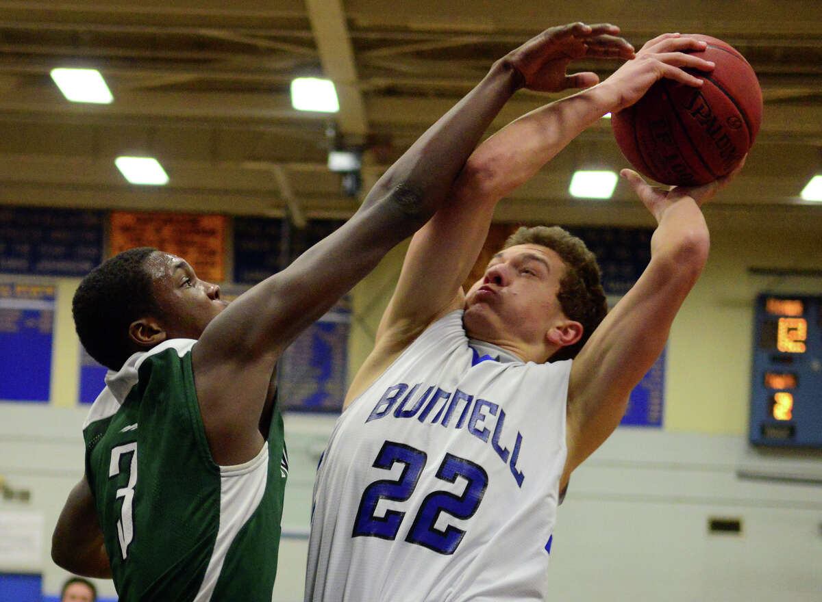 New Milford's Jhovaughn Denton, left, blocks Bunnell's Nicholas Giannoni as he attempts to score, during boys basketball action in Stratford, Conn. on Friday Feb. 27, 2015.
