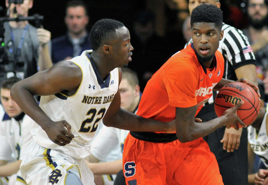 Syracuse forward B.J. Johnson (2) dribbles around Notre Dame guard Jerian Grant (22) in the first half of an NCAA college basketball game Tuesday, Feb. 24, 2015, in South Bend, Ind. (AP Photo/Joe Raymond) ORG XMIT: INJR107 Photo: Joe Raymond / FR25092 AP