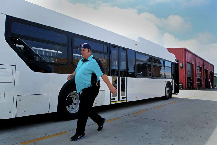 Chuck Miranda, a Compass Transportation shuttle bus driver for seven years, heads back to his bus after voting. Photo: Santiago Mejia / The Chronicle / ONLINE_YES