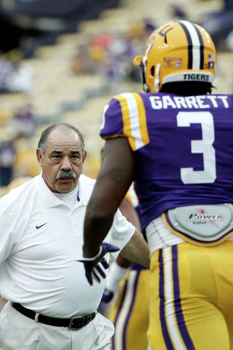 Defensive coordinator John Chavis of the LSU Tigers works with Clifton Garrett prior to a game against the Louisiana Monroe Warhawks at Tiger Stadium on September 13, 2014 in Baton Rouge, Louisiana. LSU won the game 31-0. Photo: Stacy Revere /Getty Images / 2014 Stacy Revere
