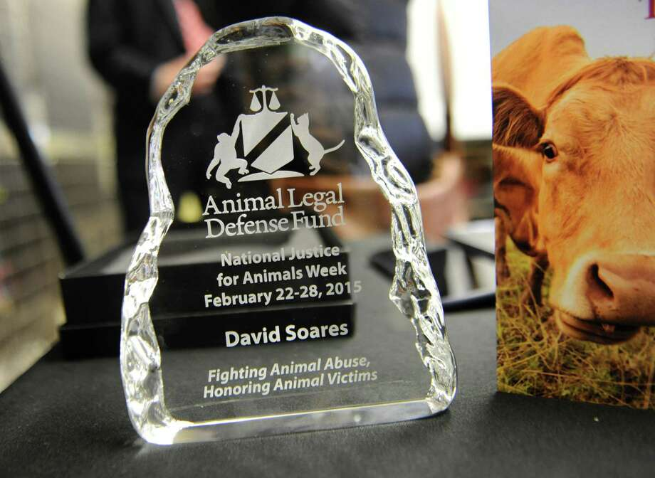 "Award given to Albany County District Attorney David Soares for a ""Top Ten Animal Defender"" from Brad Shear, Director of the Mohawk Hudson Humane Society, during National Justice for Animals Week at the Mohawk Hudson Humane Society on Friday, Feb. 27, 2015 in Albany, N.Y. (Lori Van Buren / Times Union) Photo: Lori Van Buren / 00030808A"