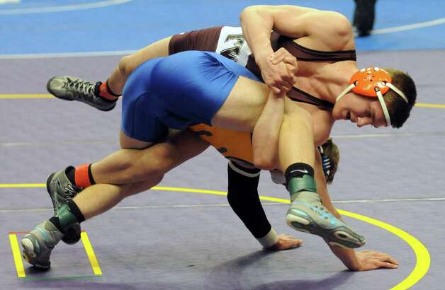 Shenendehowa's Kevin Parker went on to defeat Sonny McPherson of Indian River in their 170lb. quarterfinal match during the 2015 State Wrestling Tournament at the Times Union Center on Friday Feb. 27, 2015 in Albany, N.Y. (Michael P. Farrell/Times Union) Photo: Michael P. Farrell / 00030780A