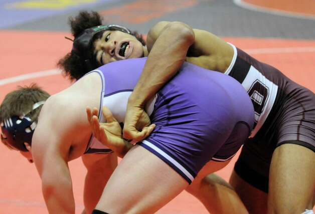 Shenendehowa's Jesse Porter went on to defeat Tristan Ierlan of Victor in their 152lb. quarterfinal match during the 2015 State Wrestling Tournament at the Times Union Center on Friday Feb. 27, 2015 in Albany, N.Y. (Michael P. Farrell/Times Union) Photo: Michael P. Farrell / 00030780A