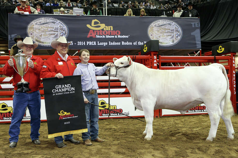 Jagger Horn (right) from Jones County 4H with his All Other Breeds steer, The White Hammer, named Grand Champion Steer during the San Antonio Stock Show and Rodeo at the AT&T center on Friday, Feb. 27, 2015.  MARVIN PFEIFFER/ mpfeiffer@express-news.net Photo: Marvin Pfeiffer, MARVIN PFEIFFER / Express-News 2015