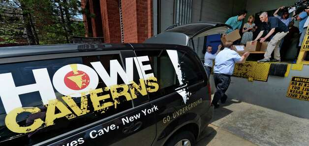 Bill Gallop, left and Chris Tague, right foreground, deliver the Howe Caverns casino license bid at the New York State Gaming building Monday afternoon June 30, 2014 in Schenectady, N.Y. The deadline for bids to hold a license for one of seven full service casinos in New York State ended Monday at 4 p.m.   (Skip Dickstein / Times Union) Photo: SKIP DICKSTEIN / 00027558A
