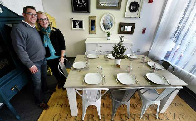John and Sarah Trop pose with recycled furniture at their new store called Funcycled Wednesday morning, Nov. 19, 2014, during the store's opening day in Troy, N.Y. (Skip Dickstein/Times Union) Photo: SKIP DICKSTEIN / 00029543A