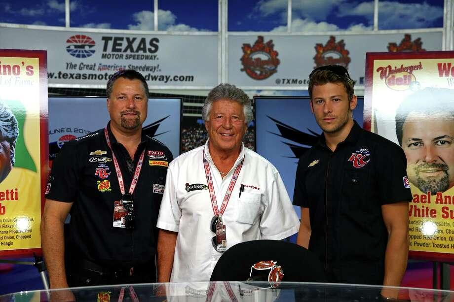FORT WORTH, TX - JUNE 07:  Former World champion racing driver Mario Andretti (C) poses with his son and team owner Michael Andretti (L) and Grandson Marco Andretti (R), driver of the #25 RC Cola Andretti Autosport Chevrolet, in the Media Center prior to practice for the IZOD IndyCar Series Firestone 550 at Texas Motor Speedway on June 7, 2013 in Fort Worth, Texas.  (Photo by Chris Graythen/Getty Images for Texas Motor Speedway) Photo: Chris Graythen / 2013 Getty Images