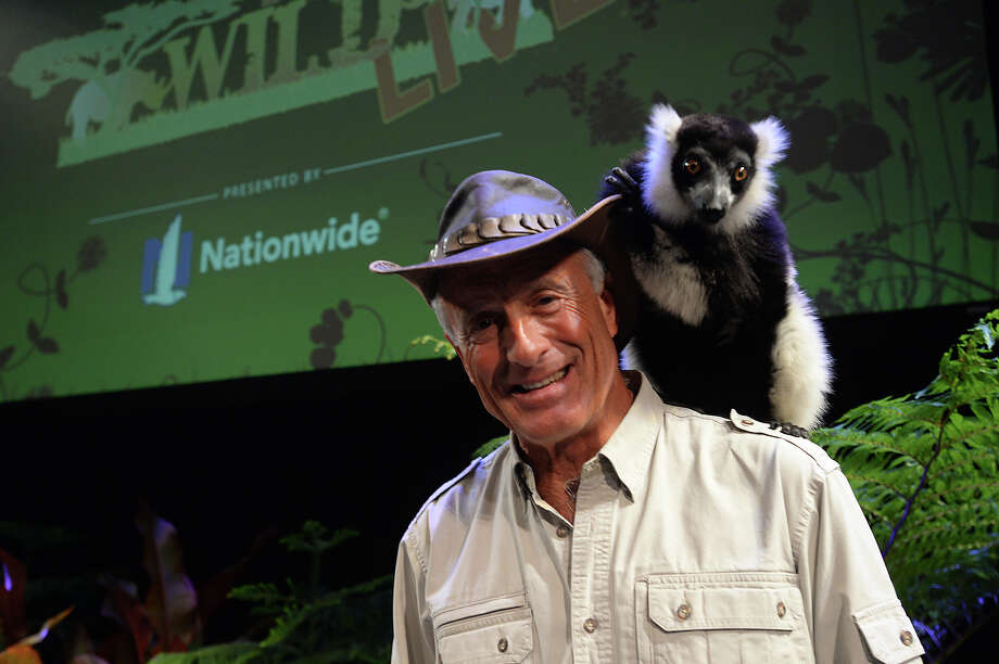 Jack Hanna, America's most famous zookeeper, pictured with a black and white ruffed lemur, brought the sights and stories behind his animal adventures to the Lutcher Theater Friday night in Orange. The animals for the show live at Zoo to You, a non-profit, rescue zoo based in San Robles, CA.  Photo taken Friday, February 27, 2015  Kim Brent/The Enterprise Photo: Kim Brent / Beaumont Enterprise