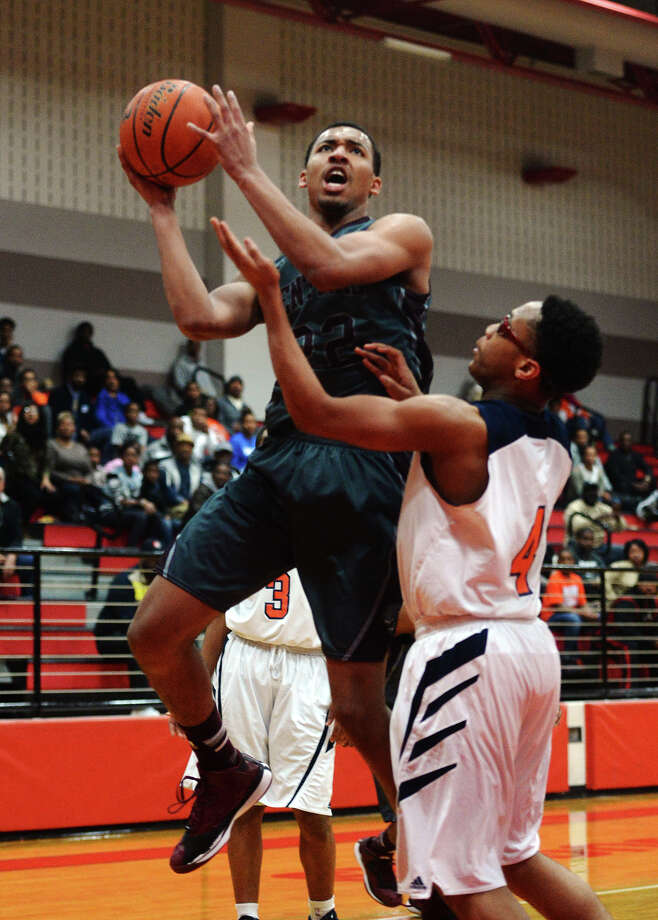 Central's Nijal Pearson, No. 22, goes up for a shot during Friday's game against Bush. The Central Jaguars played against the George Bush High School Broncos at Crosby High School on Friday evening.  Photo taken Friday 2/27/15  Jake Daniels/The Enterprise Photo: Jake Daniels / ©2014 The Beaumont Enterprise/Jake Daniels