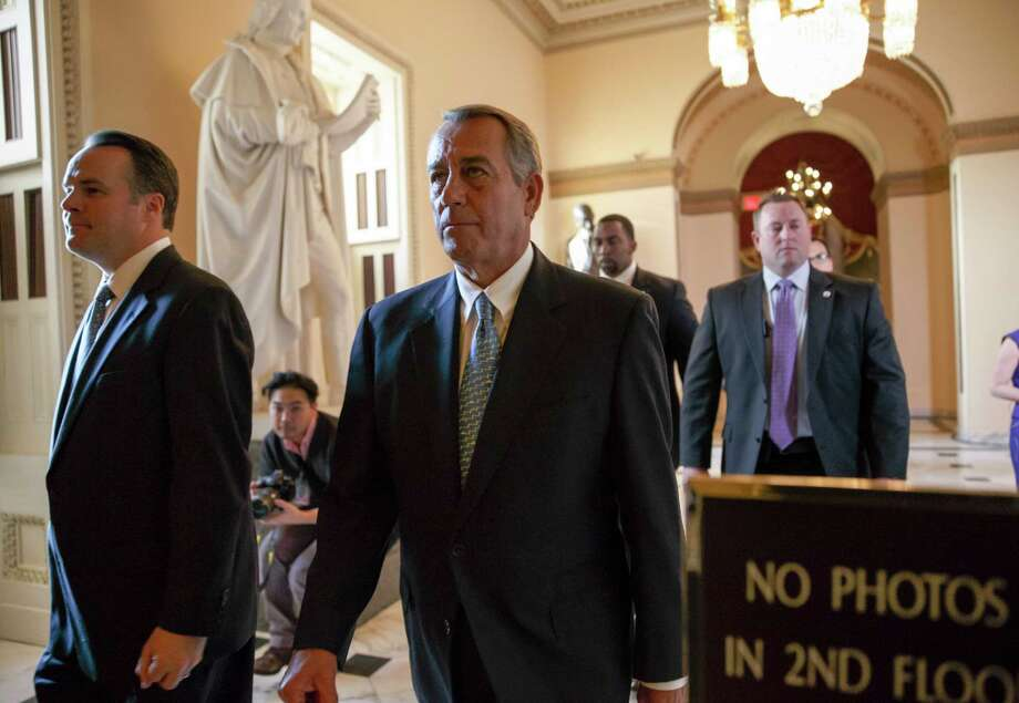 Speaker of the House John Boehner, R-Ohio, walks to the chamber as the House failed to advance a short-term funding measure to keep the Department of Homeland Security funded past a midnight deadline, at the Capitol in Washington, Friday evening, Feb. 27, 2015. Conservatives in Speaker Boehner's own party fought against three-week funding measure because it would not overturn Obama's actions on immigration.  (AP Photo/J. Scott Applewhite) ORG XMIT: DCSA128 Photo: J. Scott Applewhite / AP