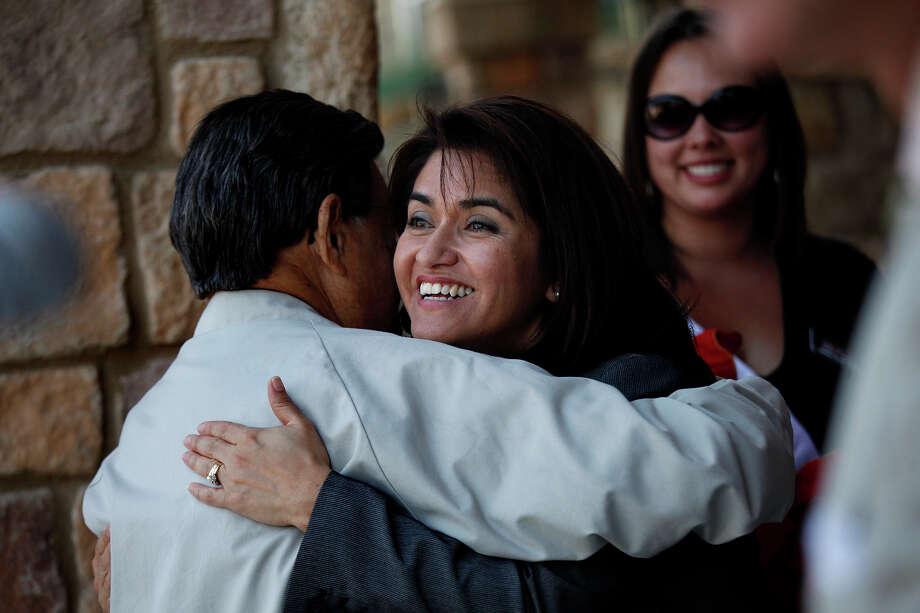 Lourdes Castro Ramirez, CEO of the San Antonio Housing Authority, embraces Samuel Ramirez  at the grand opening for a senior apartment community in May  2011. Photo: Lisa Krantz /San Antonio Express-News / SAN ANTONIO EXPRESS-NEWS